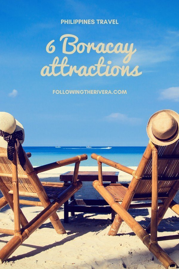 2 beach chairs with hats on the beach - Boracay attractions