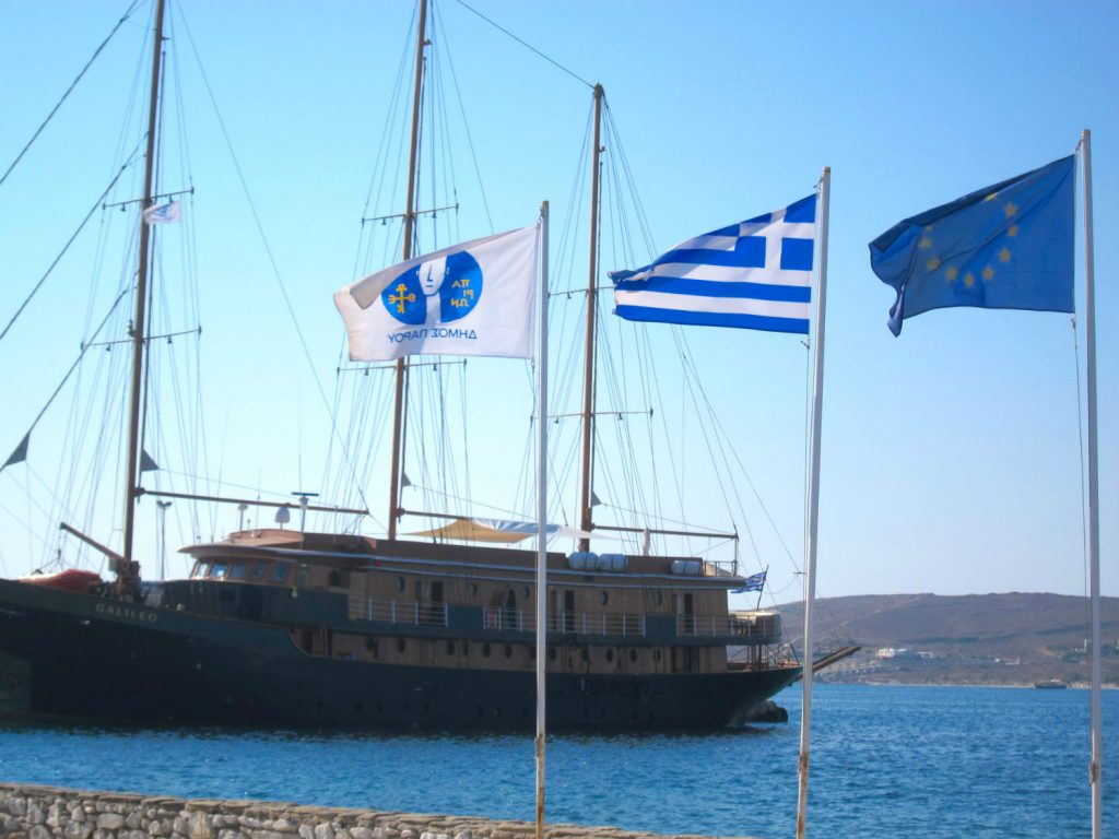 Holidays in Paros - Boat and Greek flag