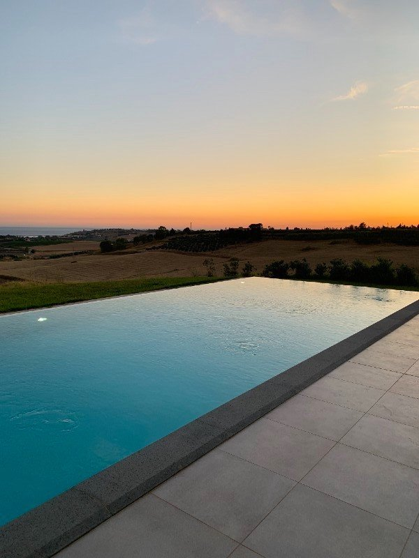 Sunset over pool at Torre Bonera Green Resort - Sicily day trips