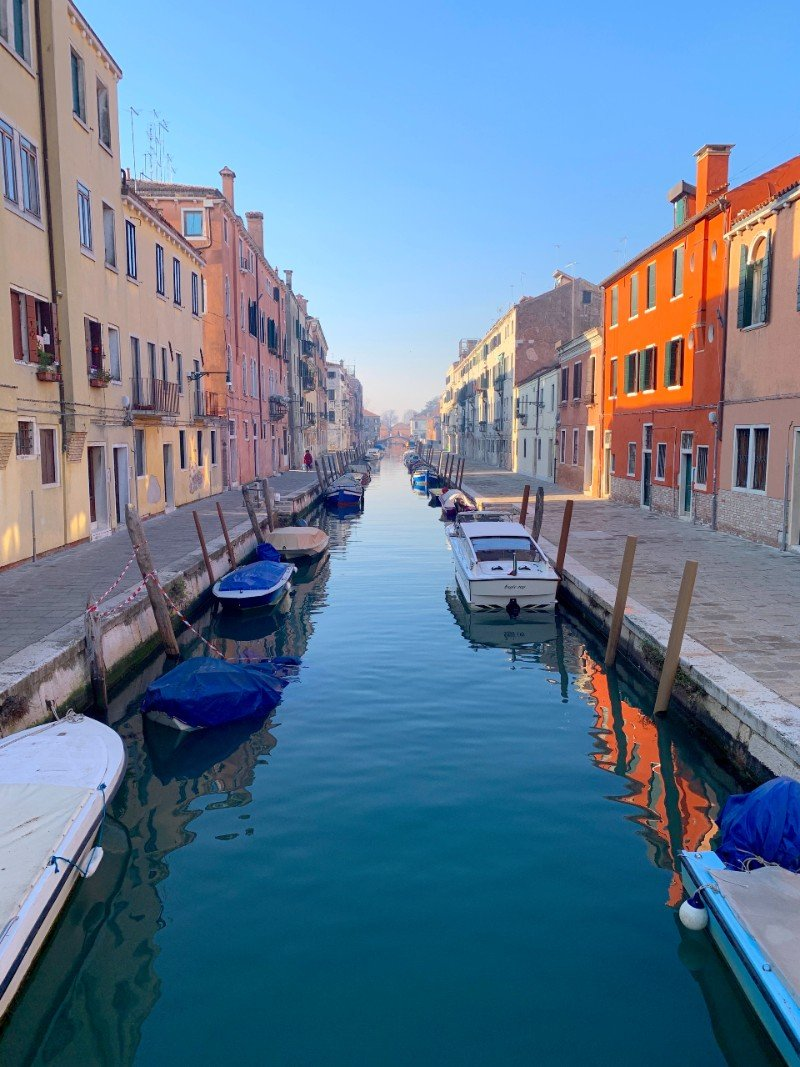 Canal in Venice with houses on either side - Venice in winter