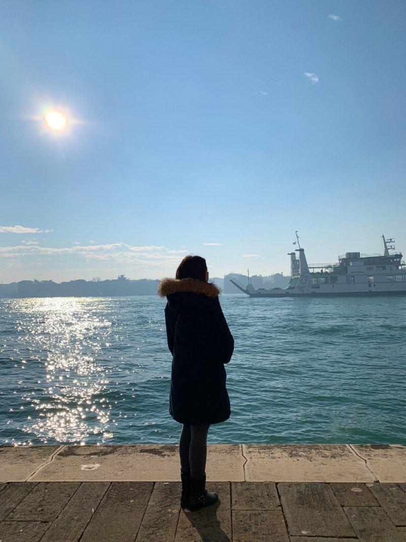 Lisa Rivera standing in Venice - Venice in winter