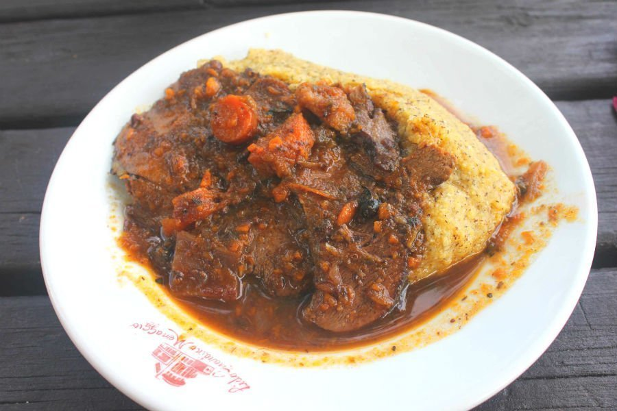 Beef stew with a portion of polenta - Italian comfort foods