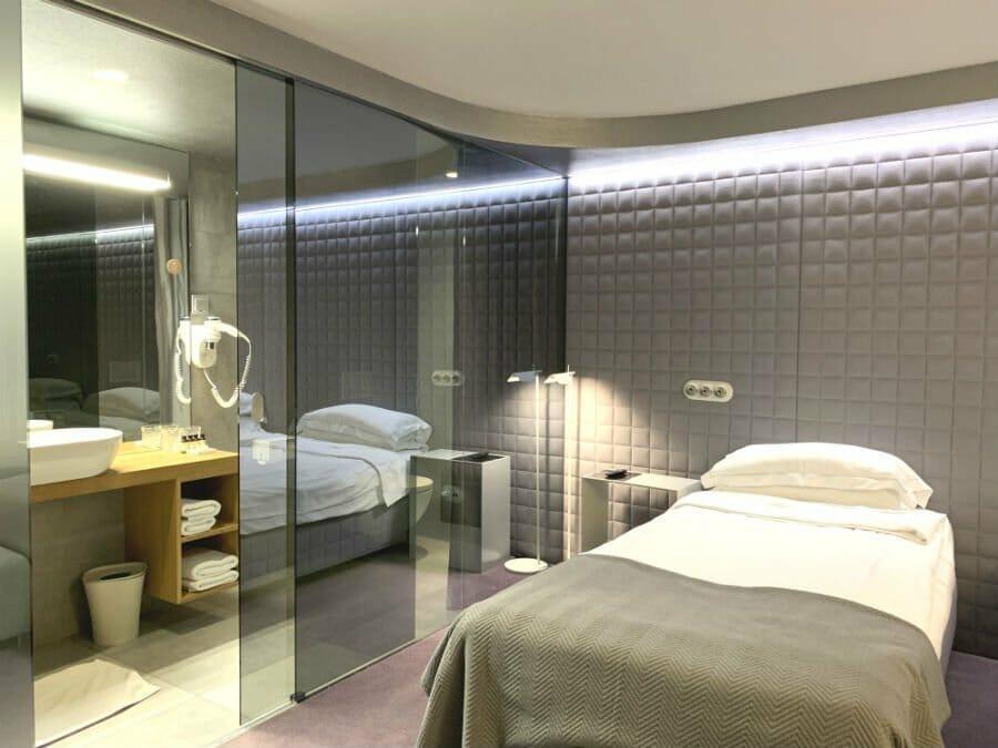 Bedroom and bathroom at Vander Hotel Ljubljana