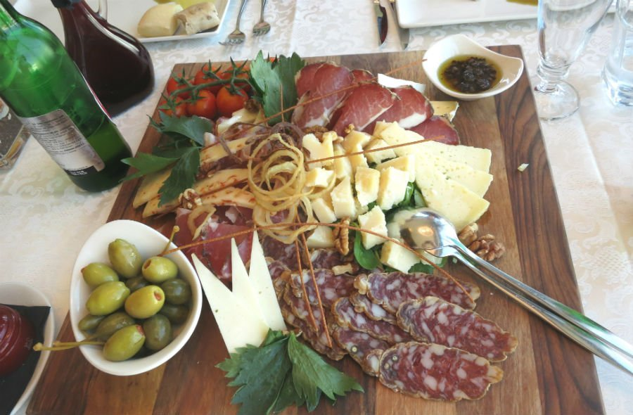 Platter of cheese, ham and olives — traditional Slovenian food