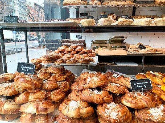 pastries in a shop display - Fabrique NYC European café NYC
