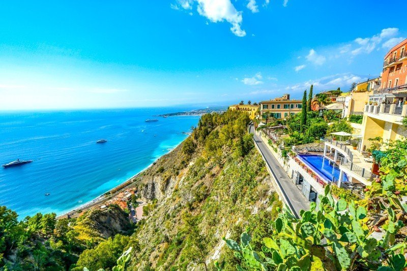 Sea and sky with green hills — plan a trip to Italy