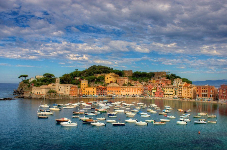 A bay of water with boats — Genoa Italy beaches