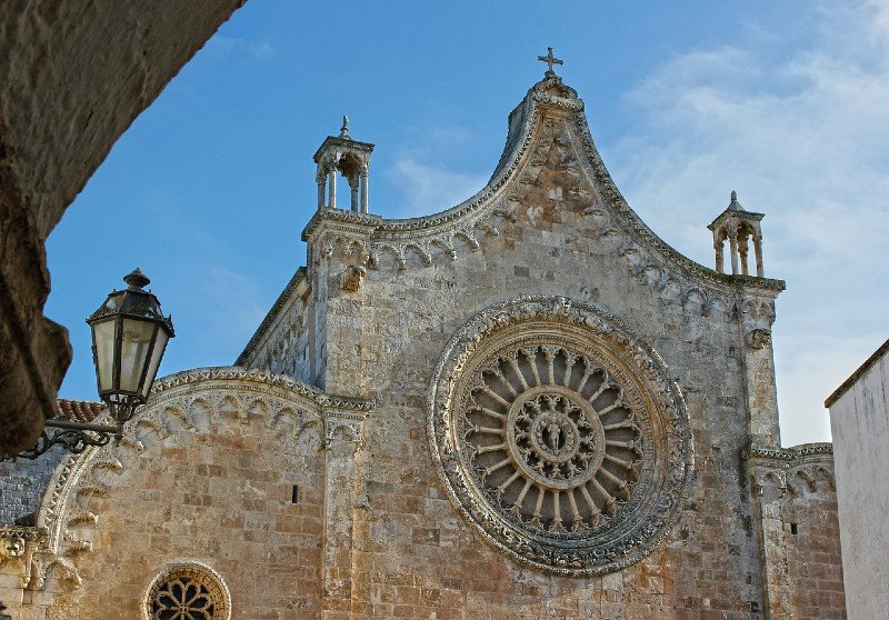 Cathedral building with a round window — best towns in Puglia