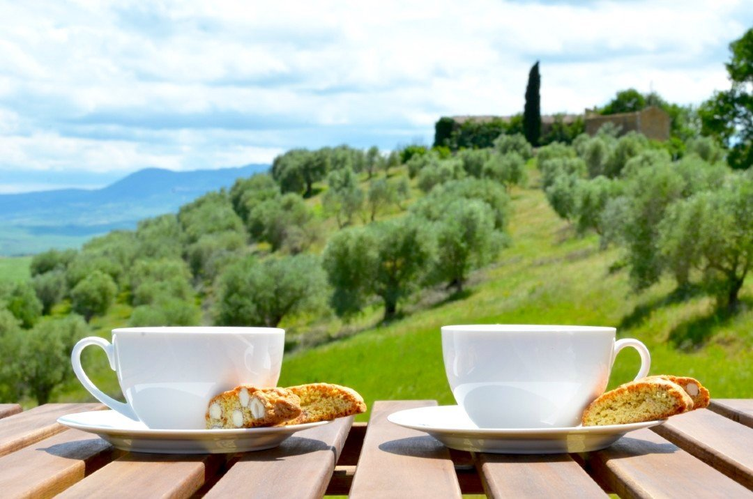 Two coffee cups with pieces of cantucci - Breakfast food in Italy