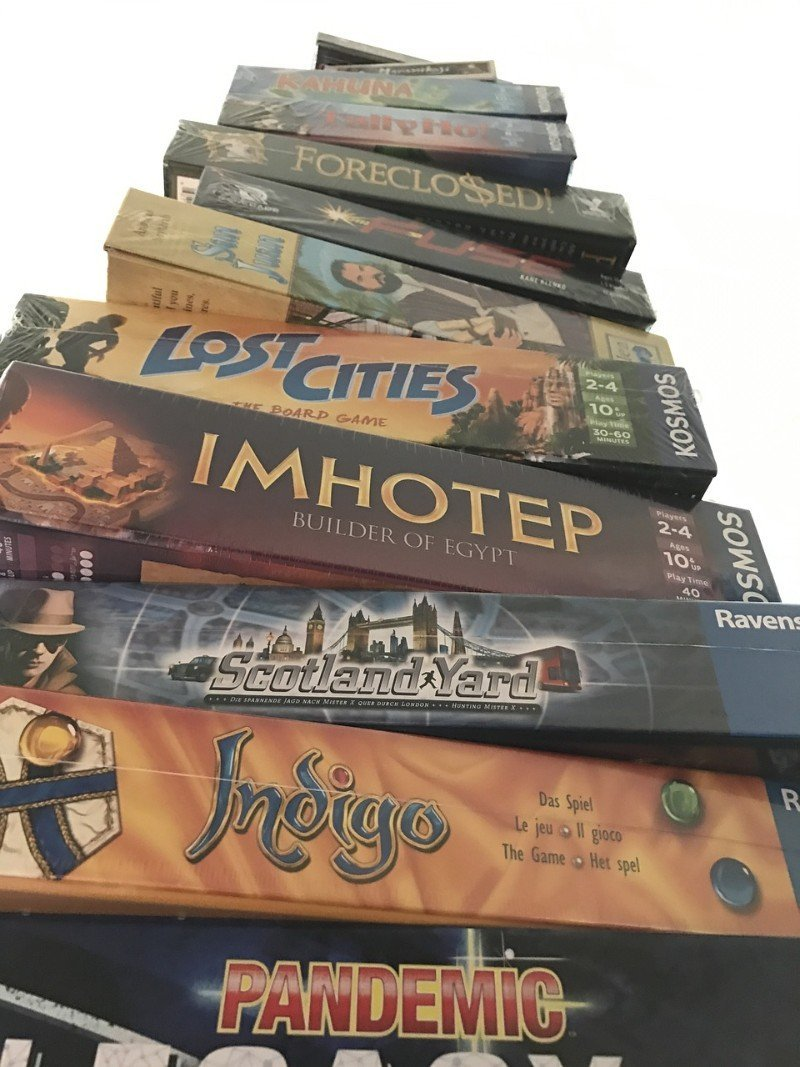 A stack of board games - things to do at night in Singapore