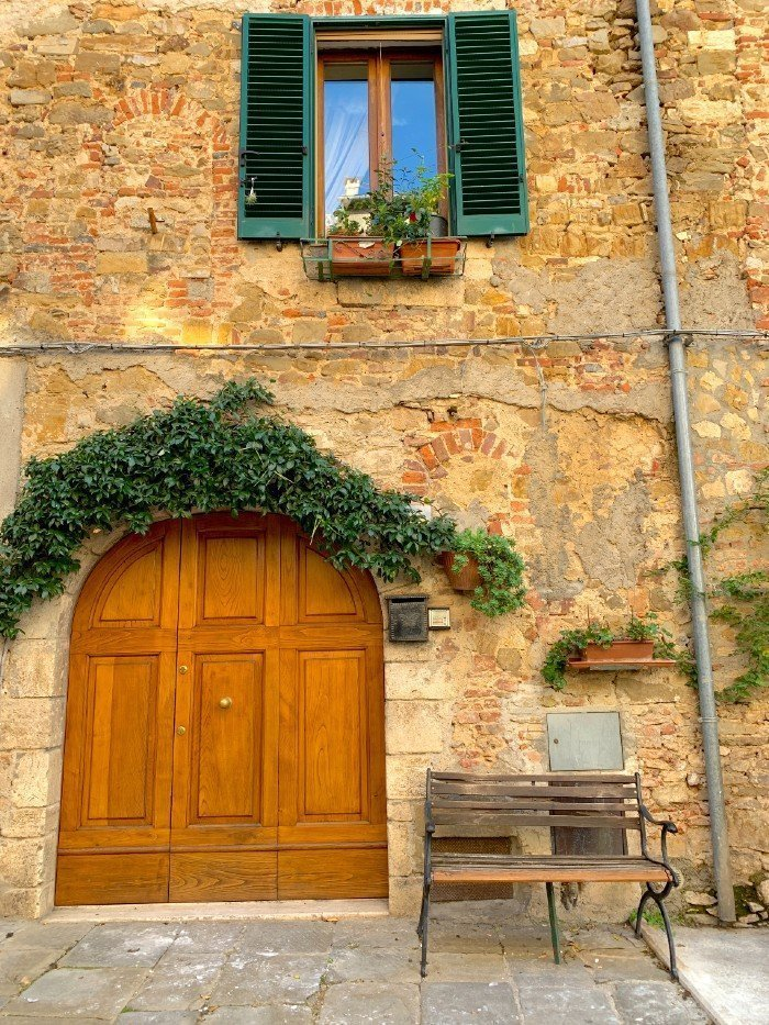 Door and bench in Montemerano - a village in Tuscany