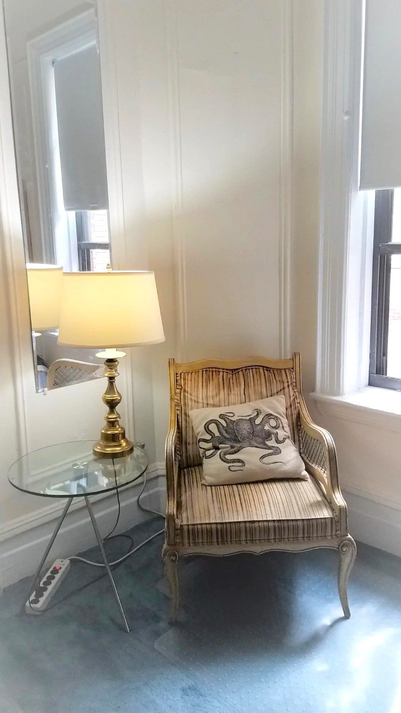 Chic chair in the bedroom - Airbnb in NYC